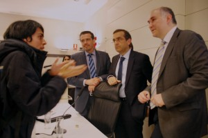 student asking questions to Pedro Ricote Lazaro of Siemens (right), and Francisco Javier Rodriguez Blanco of Nokia (center)