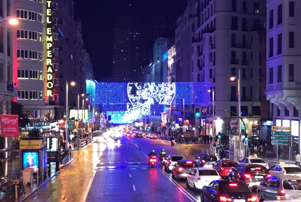Gran Via is lit up with Christmas lights on a cold December night.